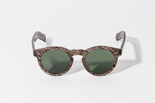 Occhiali da sole in celluloide con intarsi neri e marroni. Lente colore verde, protezione 100% dai raggi UV. Misure 46 – 23 asta 150