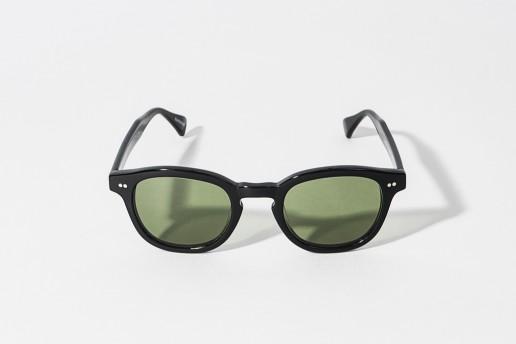 Occhiale da sole Epos in celluloide color nero. Lente verde, protezione 100% dai raggi UV. Misure 48□24 asta 145